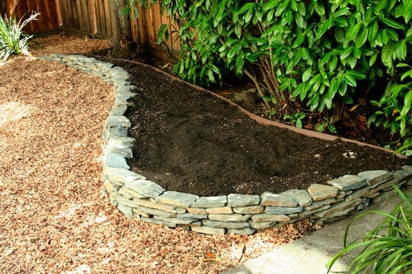 Ultra tiny super small garden the practical dink - Stone edging for garden beds ...