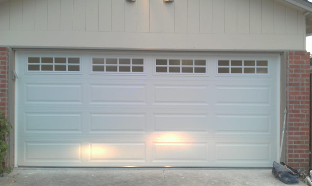 Insulated two car garage door with stockton window design for Two door garage