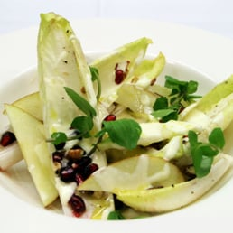 Endive, apple, pomegranate and walnut salad with gorgonzola cream.