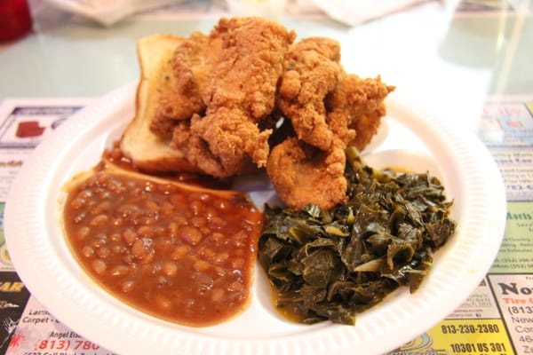 Fried catfish plate with baked beans and collared greens.   Yelp