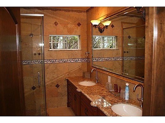 Bathroom with two sink light fixtures, shower light, Exhaust fan
