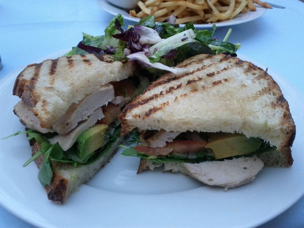 Grilled chicken breast sandwich on sourdough bread with ...