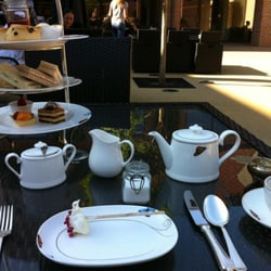 Traditional Afternoon Tea on the patio of the London Syon Park Hotel.