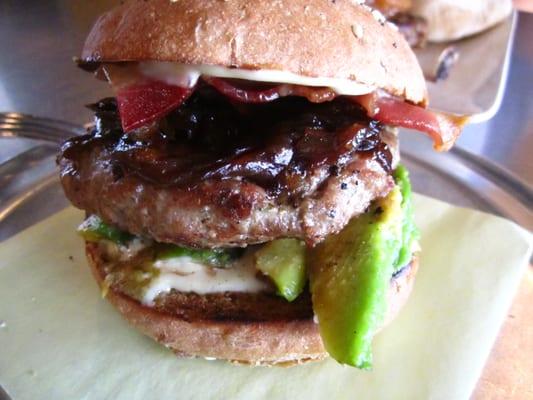 Organic Turkey Burger w/avocado, bacon & balsamic onions ($10.50)