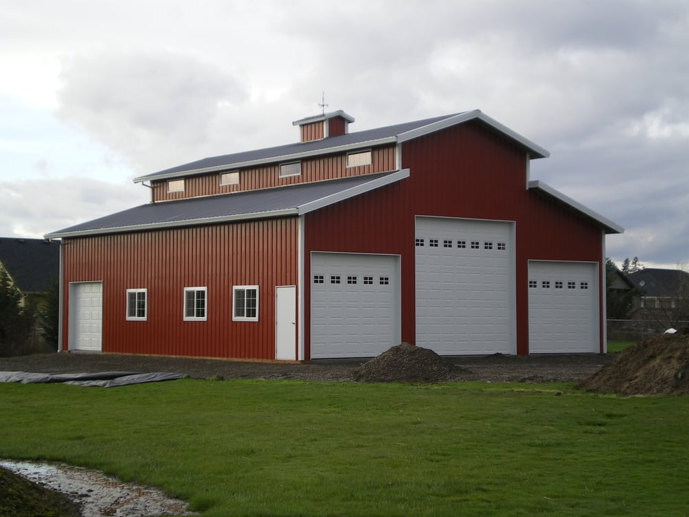 Custom Pole Building Shop Monitor Style Barn With Overhead Doors And Roof Cupola For Added