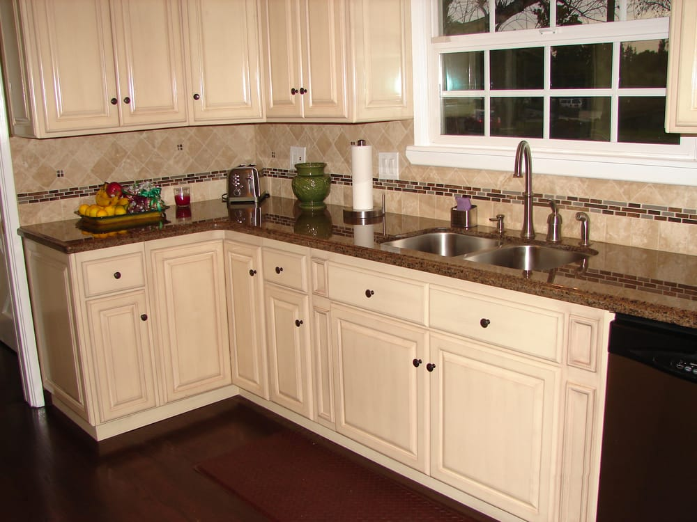 Kitchen Cabinets Near Me >> Antique White raised panel cabinets and Tropical Brown granite counter tops. Travertine/ glass