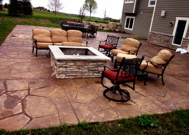Colored And Stamped Concrete Patio With Stone Fire Pit Yelp