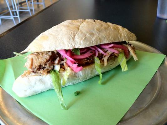Ecuadorian pulled pork sandwich with pickled red onions, cilantro and garlic aioli