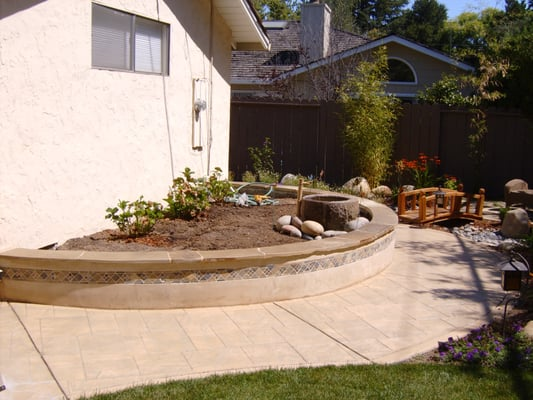 Stucco Wall With Tile Inset And Flagstone Cap Stamped