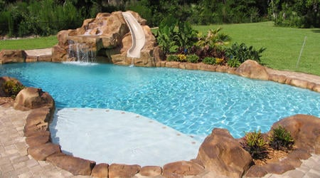 Lagoon Pool With Custom Rock Slide And Waterfall Yelp